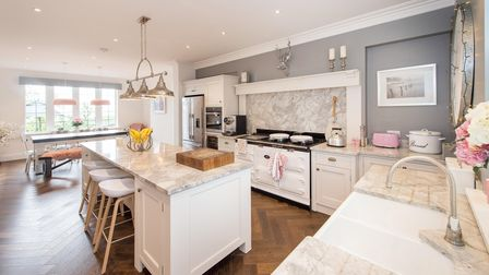 Accents of pink give this bespoke kitchen a bright and modern feel