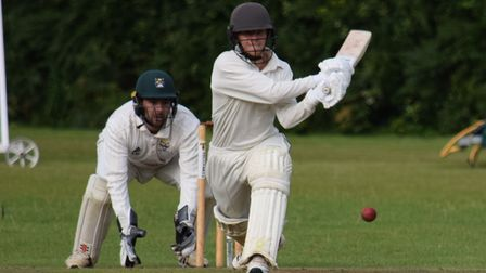 Hatherleigh batsman Jasper Presswell shapes up to reverse sweep Bovey Tracey's Will Christophers, which cost him his wicket