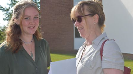 St Joseph's Collegehead girl Isabelle Atkinson celebrating exceptional results with her mum.