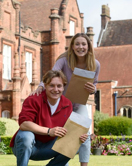 Head boy Charlie Coe and head girl Florence Grist celebrating their A-level results at Ipswich School.