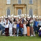 Kimbolton students celebrate their A Level resultsas a group outside the castle.