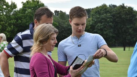 Sam Barrett looking at his results with his parents. Sam will be studying Law at York