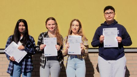 The City Academy students in Homerton hold up their A Level results.