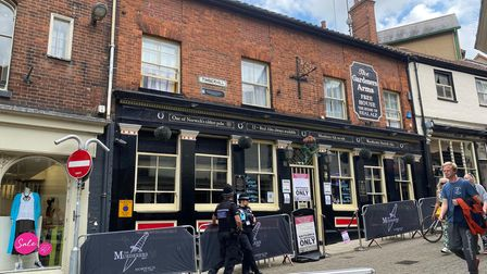 Police outside the Murderers pub in Norwich as an anti-vaccine protest took place on Tuesday afternoon