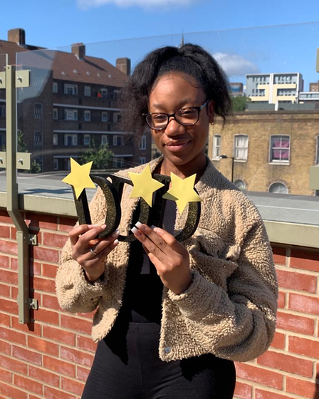 Mariam Ishola celebrates her grades in health and social care.