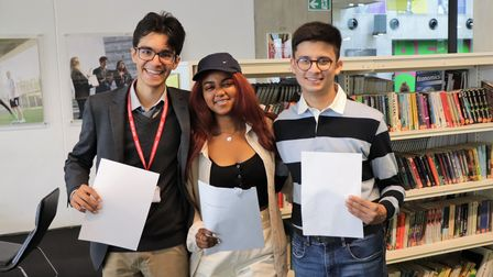 Ismail Chishti, Tejah Henningham-Dezoysa,Juned Muhith celebrate their IB results at Westminster Academy