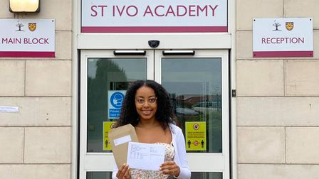 Becky celebrates her A Level results at St Ivo Academy.