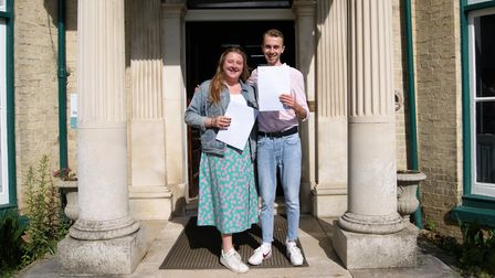 Two students from Gosfield School celebrating A Level results, Cut Hedge Park, Halstead, Essex