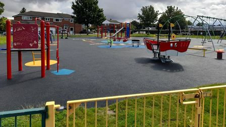 Freshly painted play equipment, including red apparatus for a slide, at the Golden Acre playground, Saffron Walden, Essex