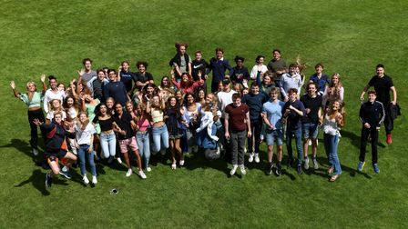 Jumping for joy: group of A Level students at Bishop's Stortford Collegestanding on a field, Essex