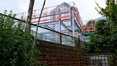 A new health centre towers over gardens in Goldhurst Terrace, South Hampstead