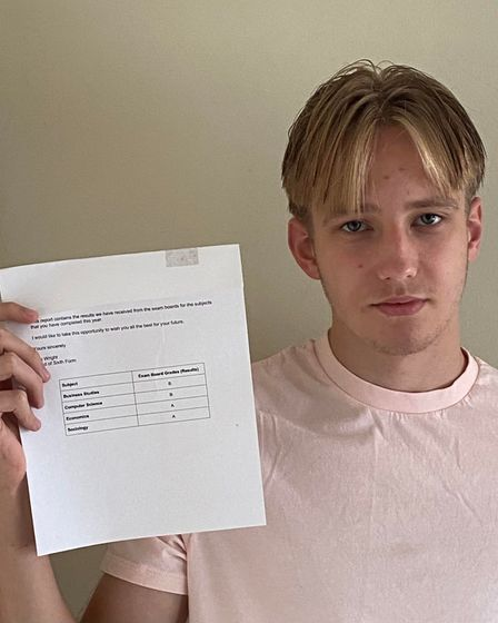 George Cook with his A Level results from Helena Romanes School and Sixth Form Centre, Great Dunmow, Essex