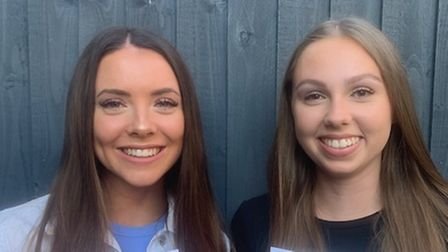 Smiling students Grace Barry and Maddy Haines with A Level paperwork, Helena Romanes School, Great Dunmow, Essex