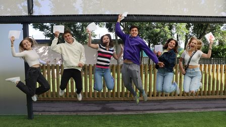 A Level students jump for joy at New Hall School, Chelmsford, Essex