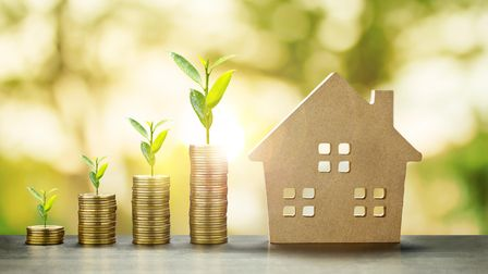 House Model and Golden Coins Stacks with blur Background.Savings Plans for Housing,Finance and Banki