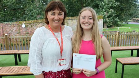 Student Daisy with her A Level results standing with New Hall School, Chelmsford Principal Katherine Jeffrey