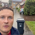 Wes Streeting during a visit to Coburg Gardens after flood waters tore through the neighbourhood on Sunday, July 25