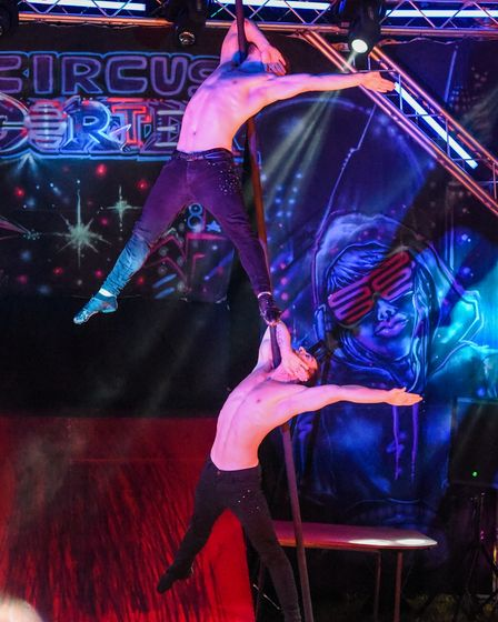 Two performers from Circus Cortex showing incredible strength during their act at their Lowestoft sh