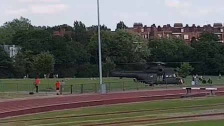 Is is a bird? No, it's a helicopter or two landing on Hampstead Heath