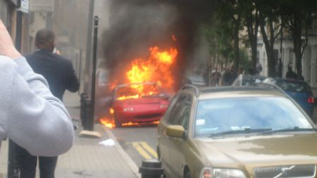 A car burning in Hackney Central during the riots