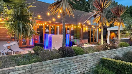 Pool house and palm trees with festoon lighting at Oak House property for sale in Halstead Essex