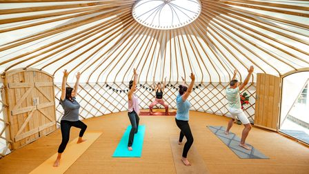 Yoga instructor Jessie Hall leading a class in the Yurt at The Clearing Wellbeing Spa, Beach Rd, Great