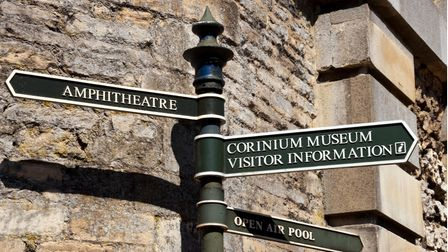 England, Gloucestershire, Cotswolds, Cirencester, tourist directions signpost outside the gates of C