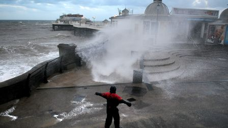 Waves smash against Cromer Pier and the sea defences at high tide.Picture: ANTONY KELLY