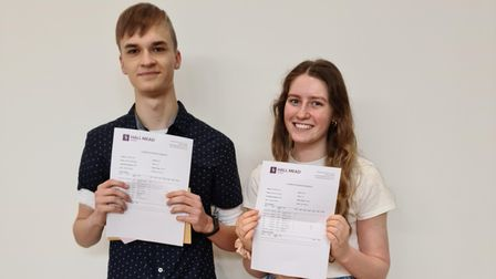 Hall Mead School students, Andriy and Emilia proudly hold up their A* grades.