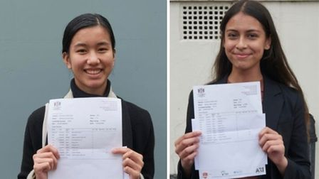 Charlene Cera (left) and Nicole Ortiz celebrate their GCSE results atCity of London Academy Highgate Hill.