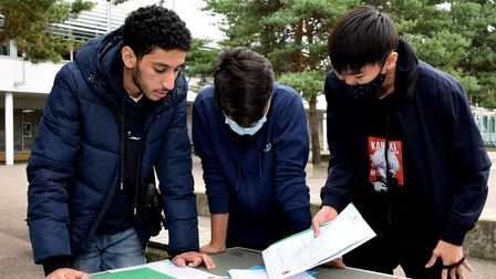 Akram Moubtassim, Jurayd Hussain and Lawrence Shao Huan Chong assess the GCSE results at Haverstock School