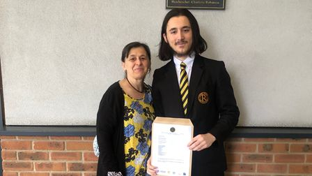 Kamer Shkrepi with his mum after collecting his GCSE results.