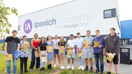 Principal of Ipswich Academy Abbie Thoringtonin the centre with Year 11 students on GSCE Results Day.