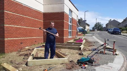 Amember of the Turning Heads team working on transforming the outdoor space at The Windmill Centre.