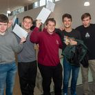 Students celebrating their GCSE results at Hans Price Academy.