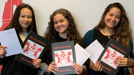 Skinners' AcademystudentsFernanda O, Laura M and Emily D show off their year books and GCSE results.