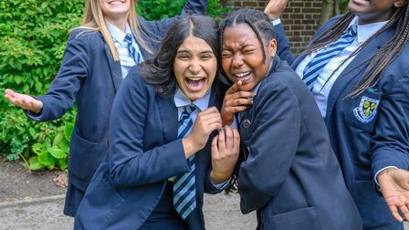 Students laughing with their friends at Wakefield Girls' High School in Yorkshire.