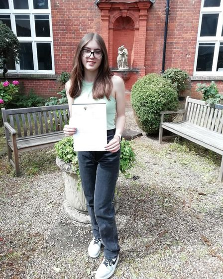 Student Martha with her GCSE results at Joyce Frankland Academy, Newport, Essex