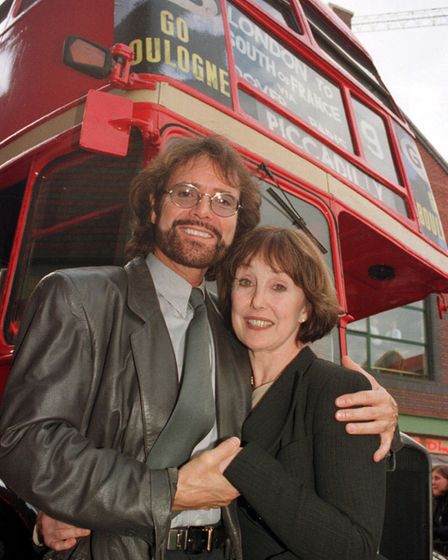 Sir Cliff Richard with Summer Holiday co-star Una Stubbs and ared double-decker bus in Birmingham in 1996.