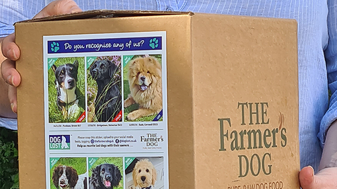 A box of The Farmer's Dog raw food with DogLost missing dogs campaign on the side