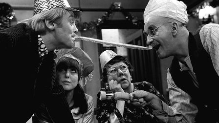 File photo from 1966 of Tony Booth, Una Stubbs, Dandy Nichols, and Warren Mitchell on the set of Till Death Us Do Part
