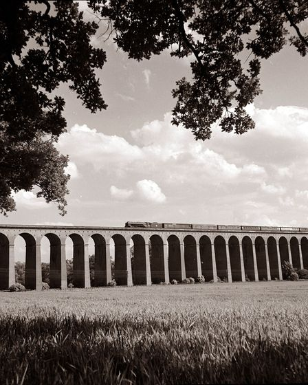 View of Railway Viaduct in Digswell Hertfordshire in England A train is passing over