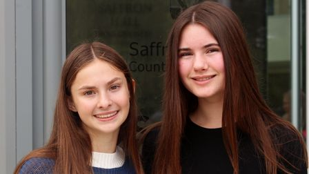 Two students from Saffron Walden County High School, Essex, celebrating their GCSE exam results