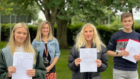 Students picked up their results from the school on Thursday.