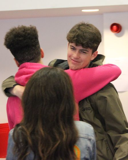 Cyrus Walsh is given a congratulatory hug at Ark Academy on his top GCSE results