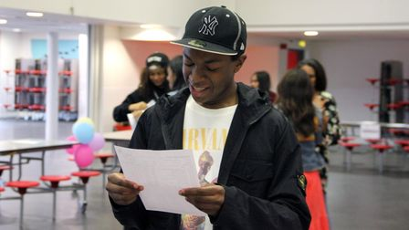Ishmael Pemberton clearly pleased with his five 9s, two8s, two 7s and A grade in additional maths