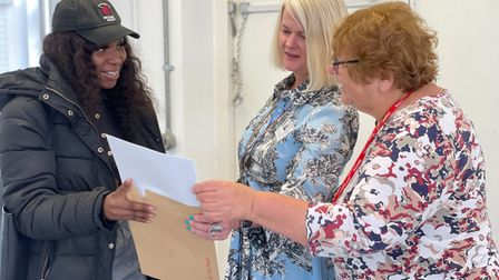 Ruth from Haringey Learning Partnership shows council bigwigs her exam results