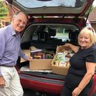 Torquay Rotary Club president Gerald Arnold packs up the food boxes with Susie Petford of Paignton Rotary Club.
