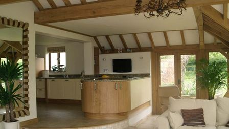 Kitchen and living room oak-framed home extension from Mitre Oak Ltd in the Cotswolds