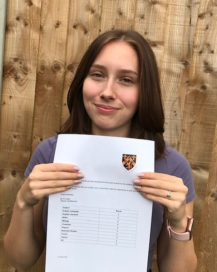 A female student with GCSE results certificate at The Helena Romanes School and Sixth Form Centre, Great Dunmow, Essex